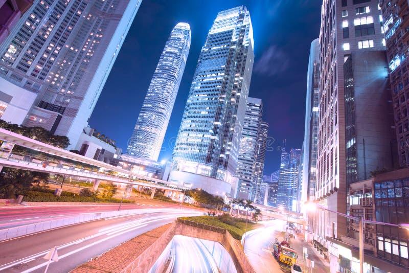 香港商业区在与轻的足迹的晚上 库存照片