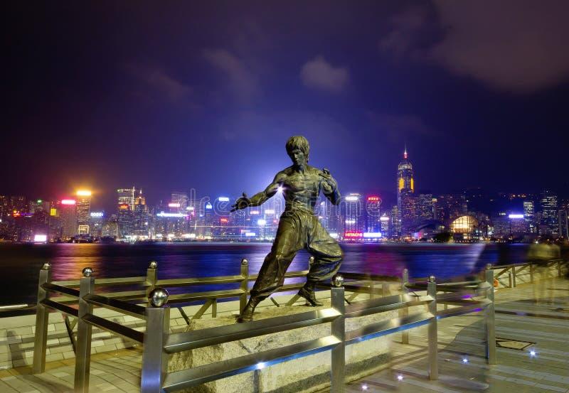 香港,中国,李小龙雕象维多利亚港口江边的  图库摄影