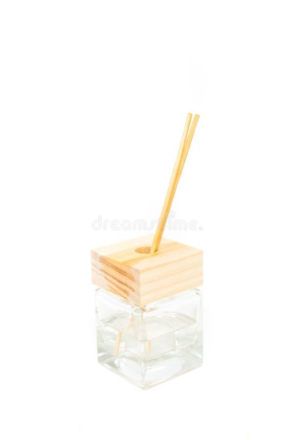 香火棍子在方形的瓶的芳香油 免版税库存图片