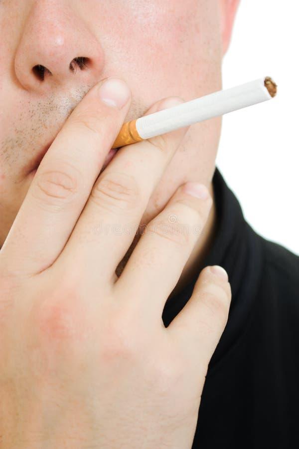 香烟他的人嘴 免版税库存图片