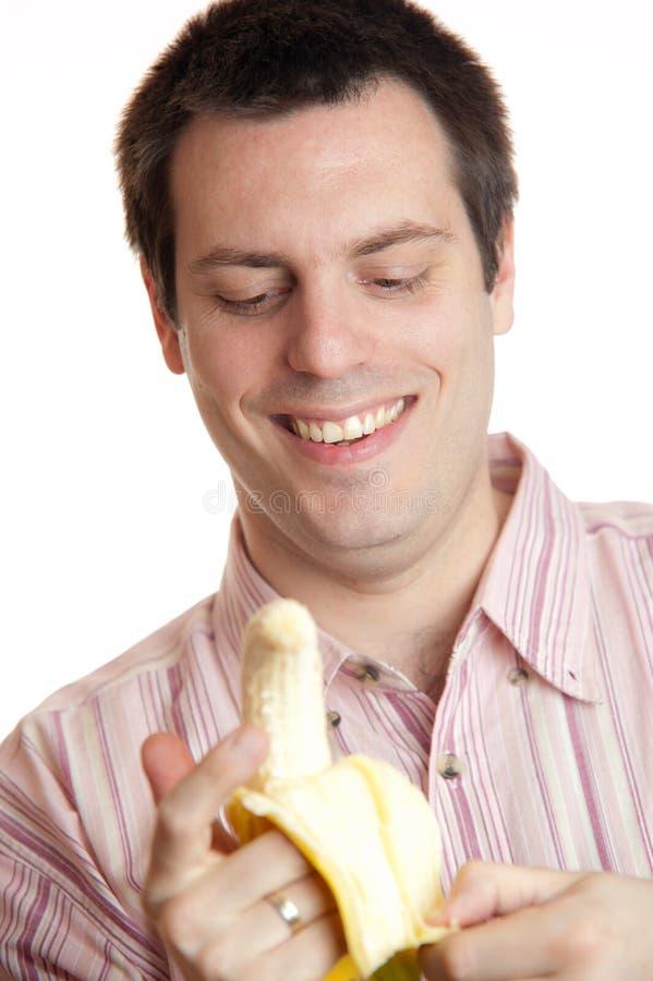 香蕉人发隆隆声的年轻人 免版税库存图片