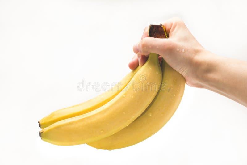 香蕉在手中 隔离 免版税库存照片