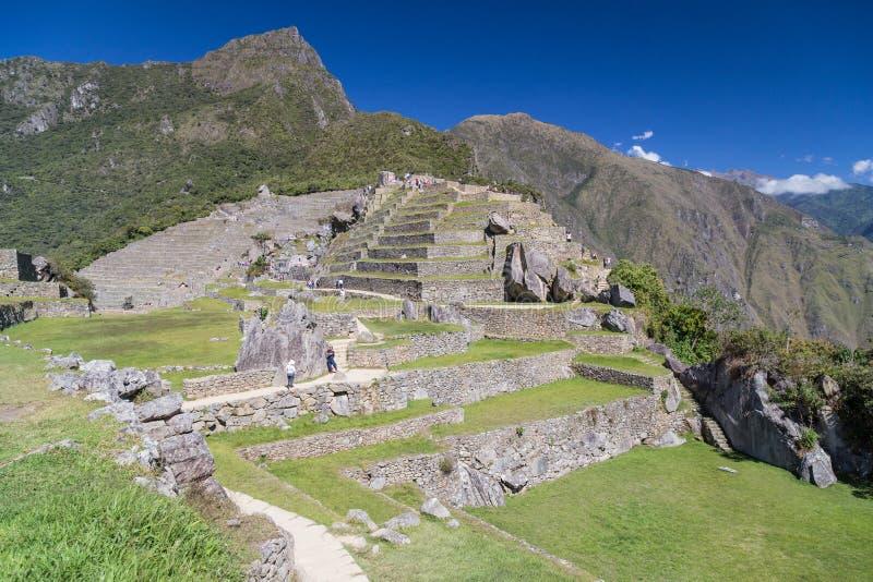 马丘比丘,阿瓜斯卡连特斯火山/秘鲁-大约2015年6月:印加人马丘比丘神圣的失去的市废墟在秘鲁 免版税图库摄影