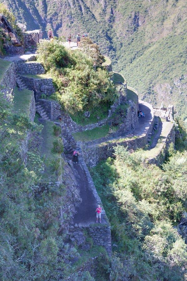 马丘比丘,阿瓜斯卡连特斯火山/秘鲁-大约2015年6月:从印加人马丘比丘神圣的失去的市的顶端大阳台在秘鲁 库存图片