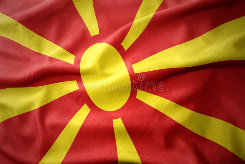 马其顿的挥动的五颜六色的旗子 免版税库存图片