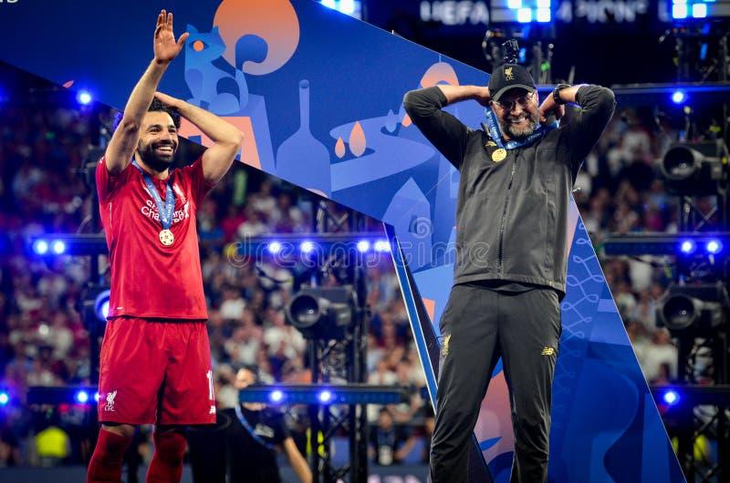 马德里,西班牙- 2019年5月01日:穆罕默德塞古和尤尔根・克洛普庆祝他们赢得在以后的欧洲联赛冠军杯2019年 免版税图库摄影