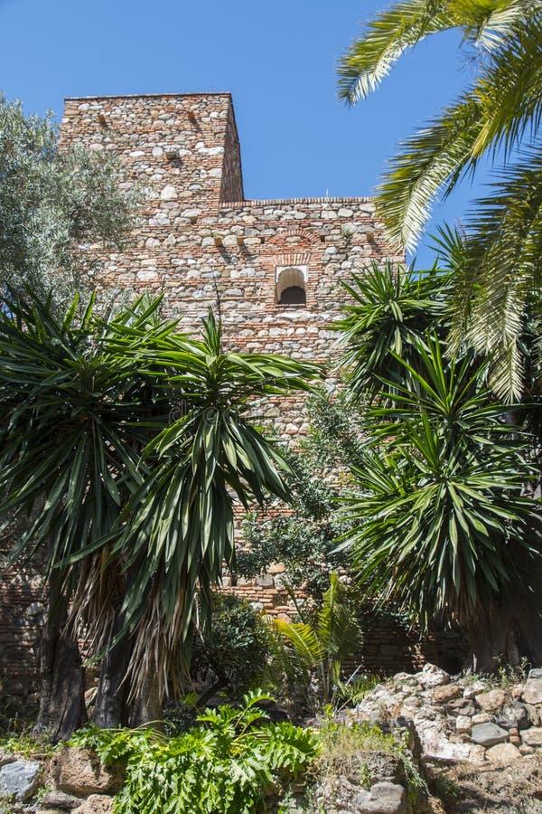 马拉加,西班牙- 2019年3月28日:Alcazaba堡垒的古老塔在马拉加,安大路西亚 库存照片