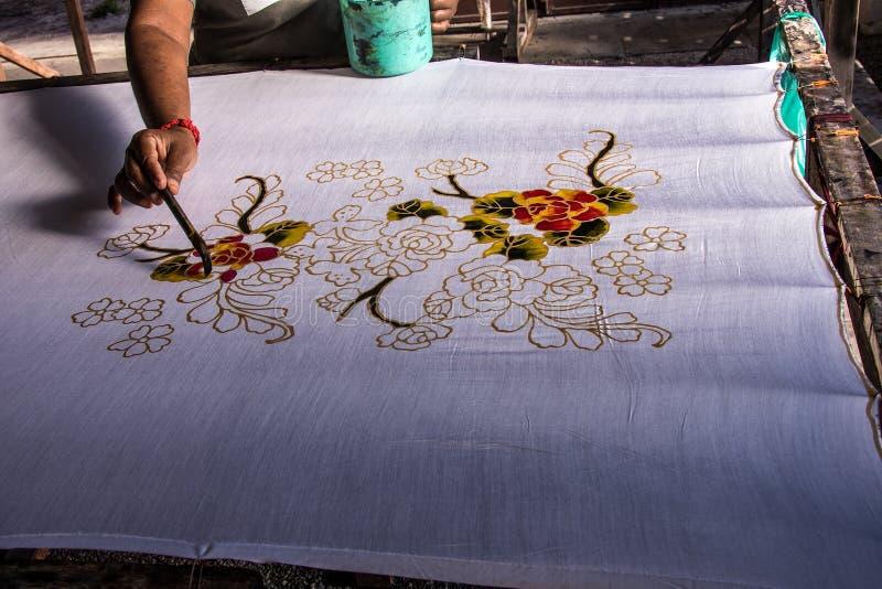 马来的蜡染布艺术古老技术  库存照片