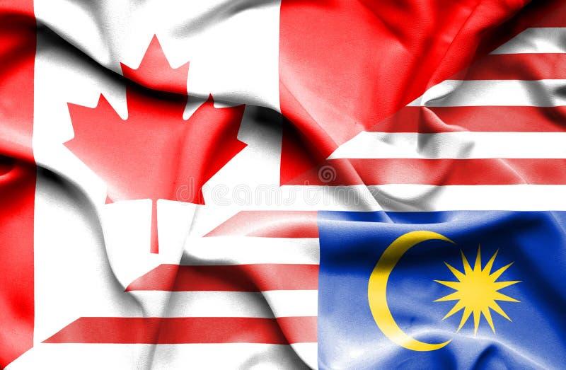 马来西亚和加拿大的挥动的旗子 皇族释放例证