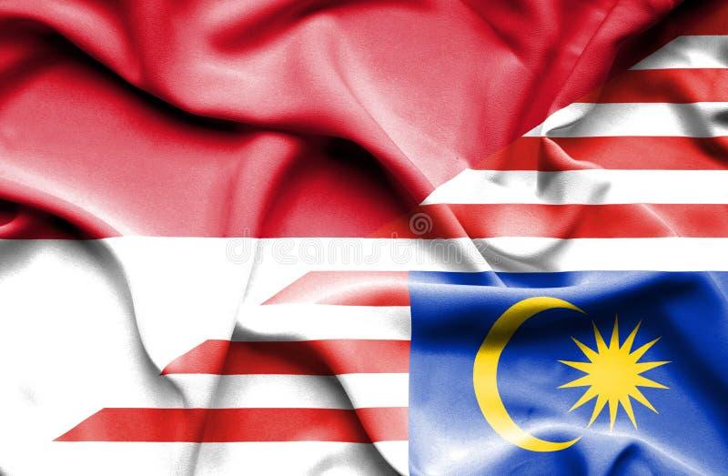 马来西亚和摩纳哥的挥动的旗子 皇族释放例证