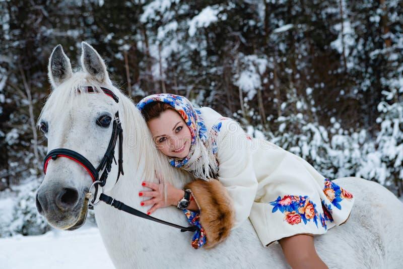 马的绅士妇女 免版税库存图片