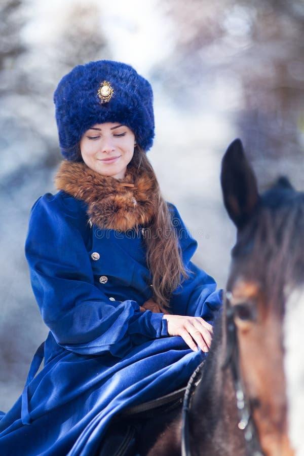 马的绅士妇女 库存照片