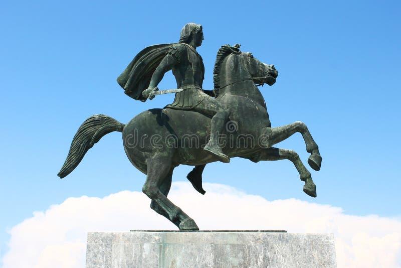 马被氧化的古铜色雕象的战士 库存照片