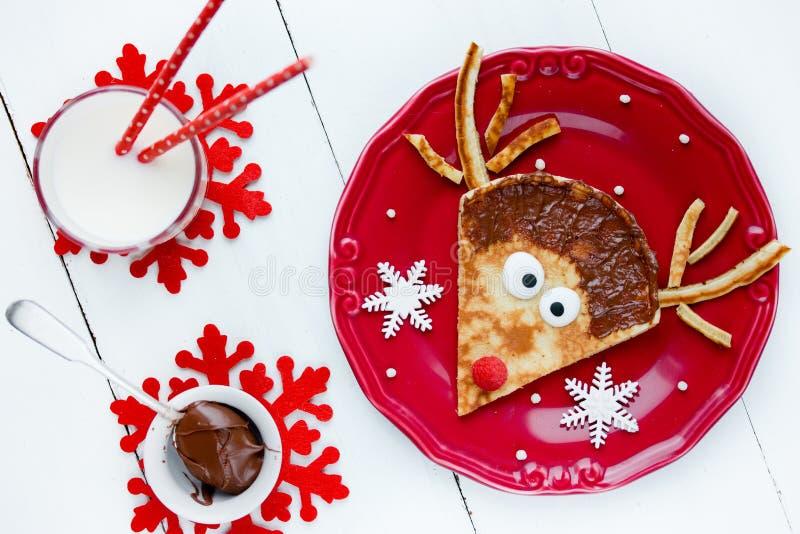 驯鹿薄煎饼-逗人喜爱和滑稽的圣诞节新年食物艺术id 免版税库存图片