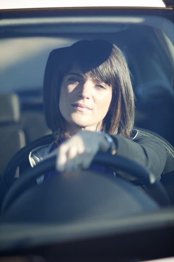 驾车她新的妇女 免版税库存照片