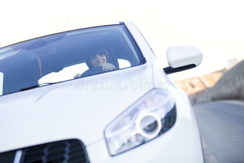 驾车她新的妇女 库存照片