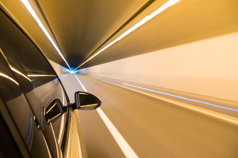 驾车快速的出口隧道 免版税库存照片
