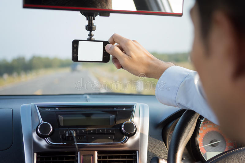 驾驶汽车的录影机 免版税库存照片