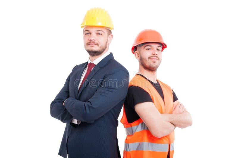 骄傲或确信的工程师和商人 库存照片