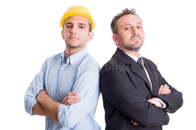 骄傲的工程师和商人紧接 库存照片