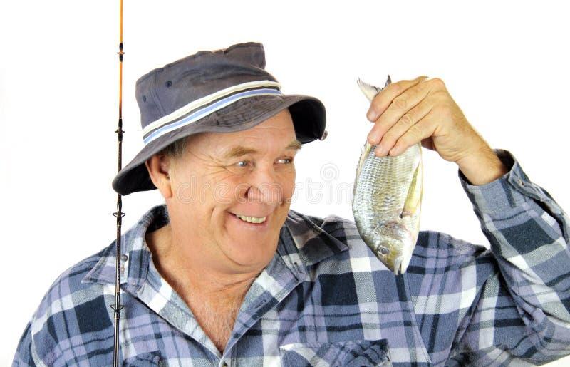 骄傲的渔夫 免版税库存图片