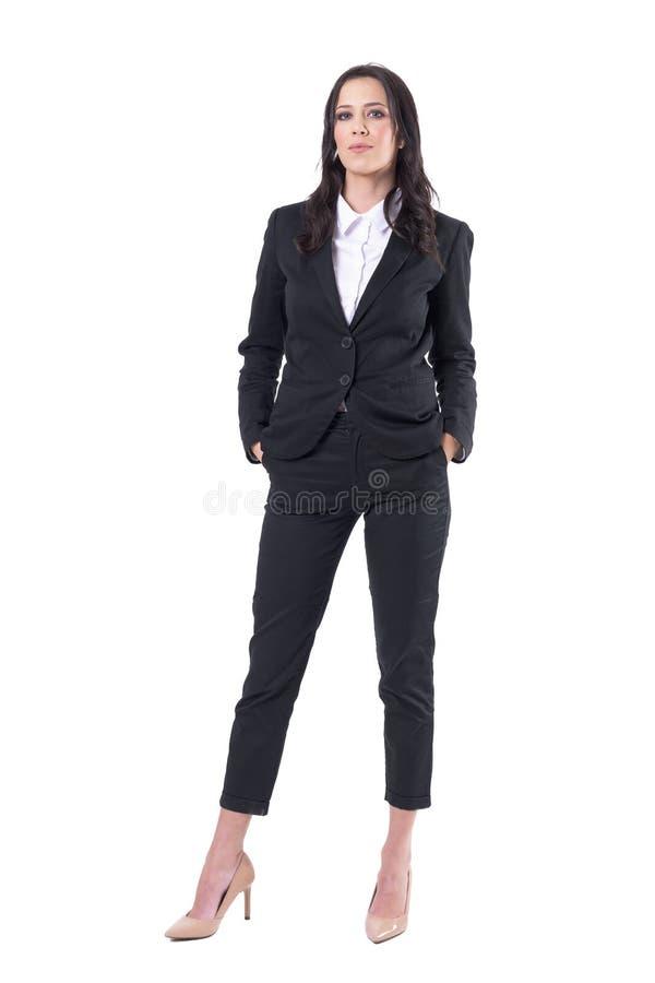 骄傲的确信的成功的女实业家经理用在口袋的手 库存图片