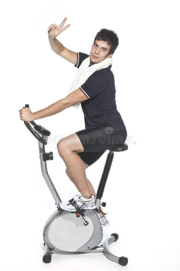 骑自行车固定式人的脚蹬谁 库存照片
