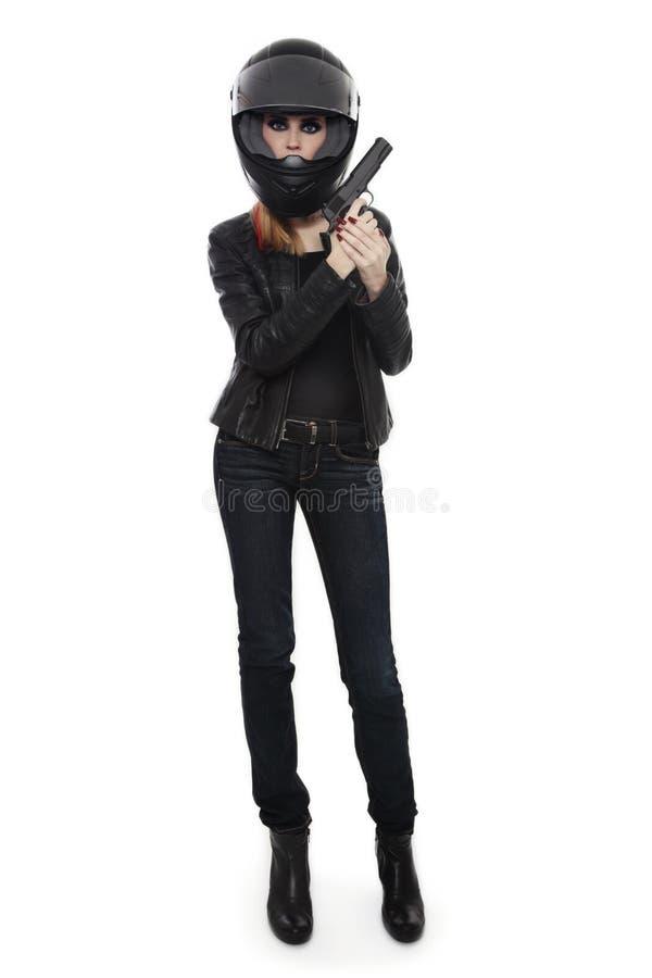 骑自行车的人盔甲的妇女与枪 免版税库存图片