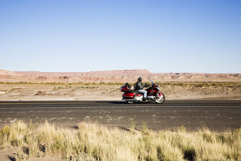 骑自行车的人高速公路 库存照片