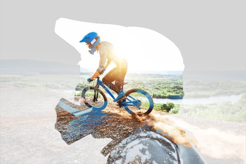 骑自行车者的两次曝光画象 免版税库存照片