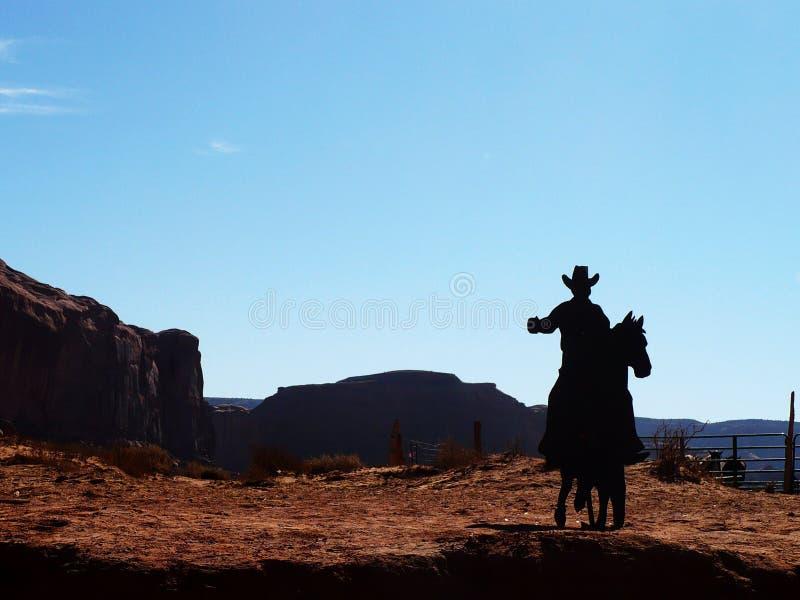 骑马牛仔 图库摄影