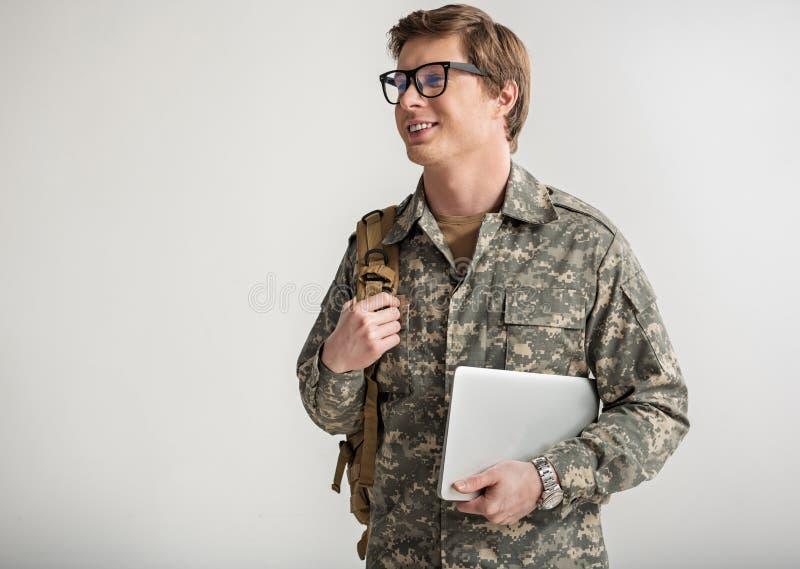 高兴的军事人向学习求助 库存图片