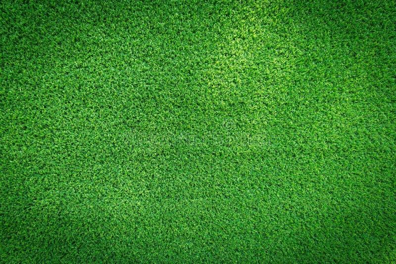 高尔夫球场、足球场或者体育背景构思设计的草地纹理 免版税库存图片