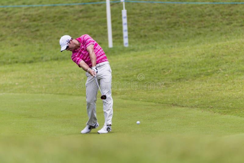 高尔夫球能手Casey摇摆 免版税图库摄影