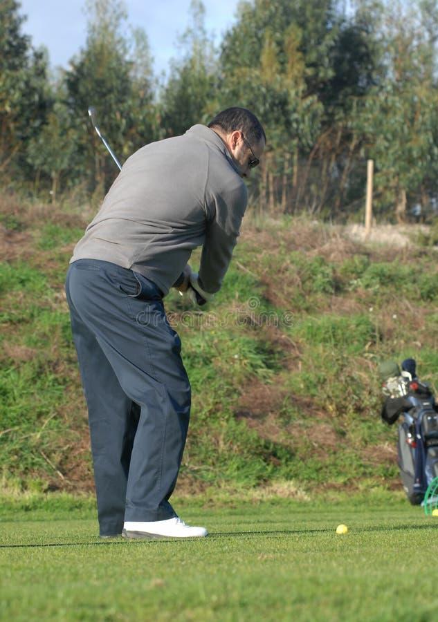 高尔夫球运动员培训 图库摄影