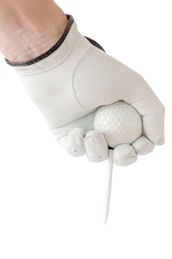 高尔夫球运动员手和与发球区域的高尔夫球的行动在白色手套的 免版税图库摄影