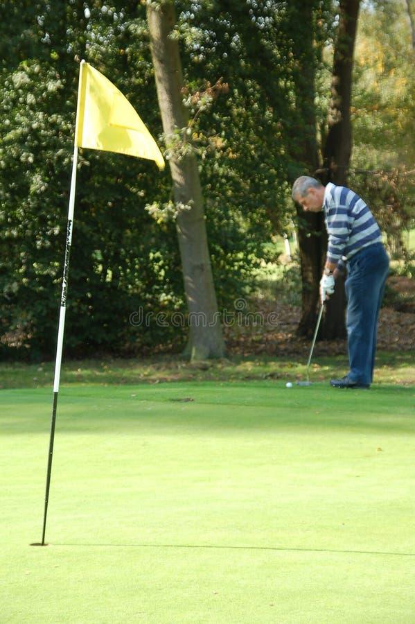 高尔夫球运动员男放置 图库摄影