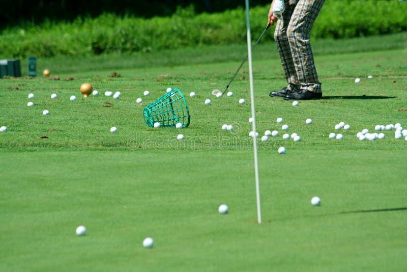高尔夫球运动员裤子实践减速火箭 免版税库存图片
