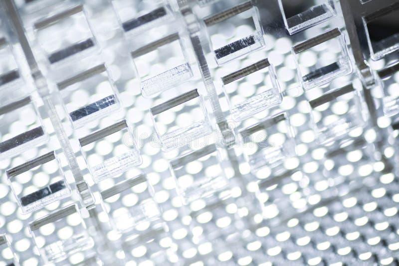 高技术抽象背景 透明塑料或玻璃板料与被删去的孔 激光切口  免版税库存图片