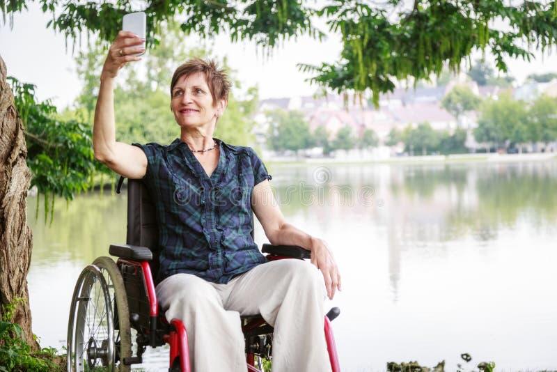高级轮椅妇女 图库摄影