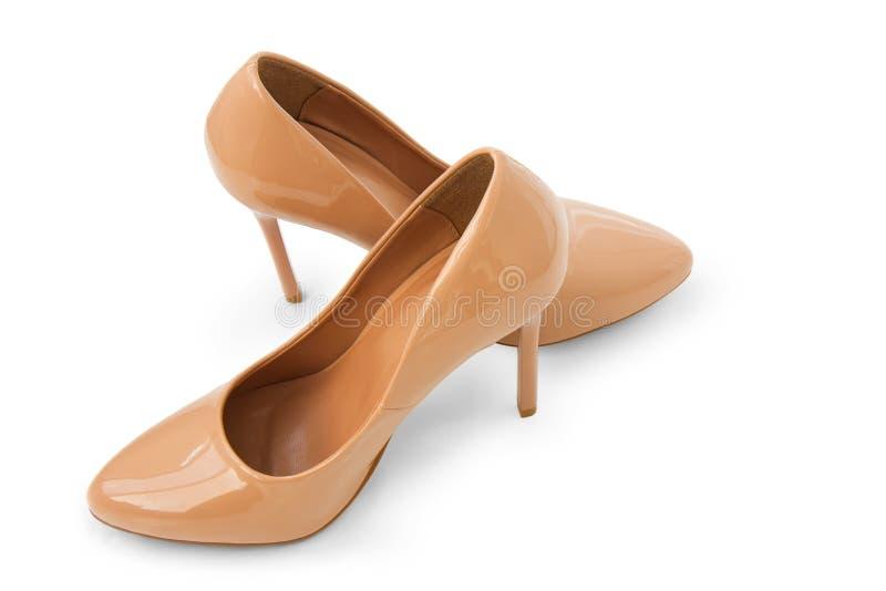 高跟时尚米黄妇女的鞋子 库存图片