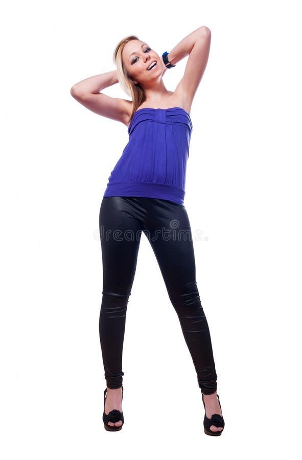 高跟鞋的美丽的微笑的性感的女孩 免版税库存图片
