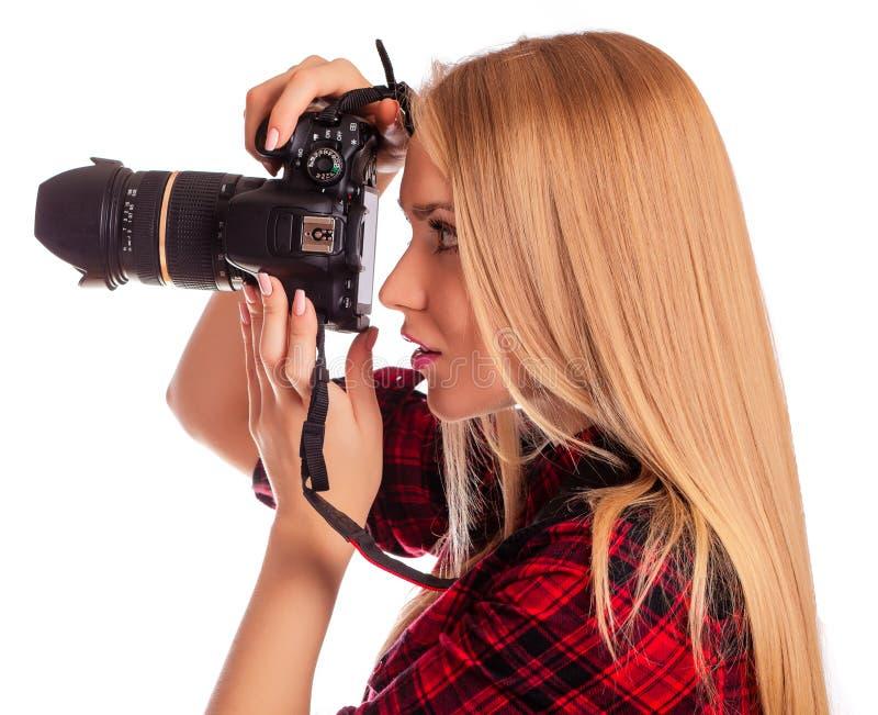 魅力妇女摄影师采取在白色-隔绝的图象 免版税库存照片