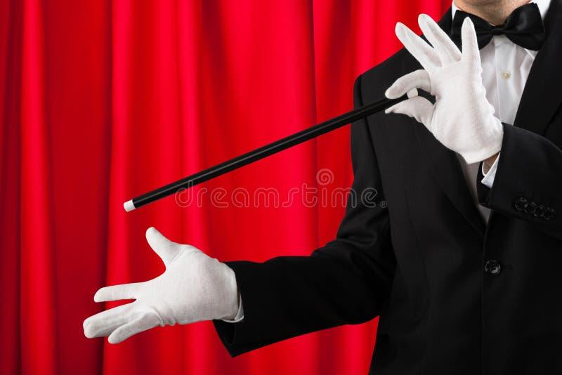 魔术师陈列把戏特写镜头  免版税图库摄影