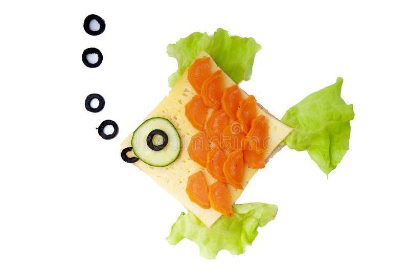 鱼为孩子将夹在中间 免版税库存照片