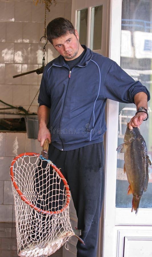 鱼卖主 图库摄影