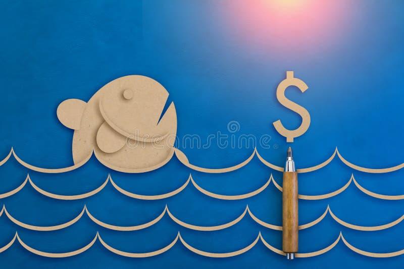 鱼和金钱标志纸在蓝色皮革背景切开了 免版税库存图片