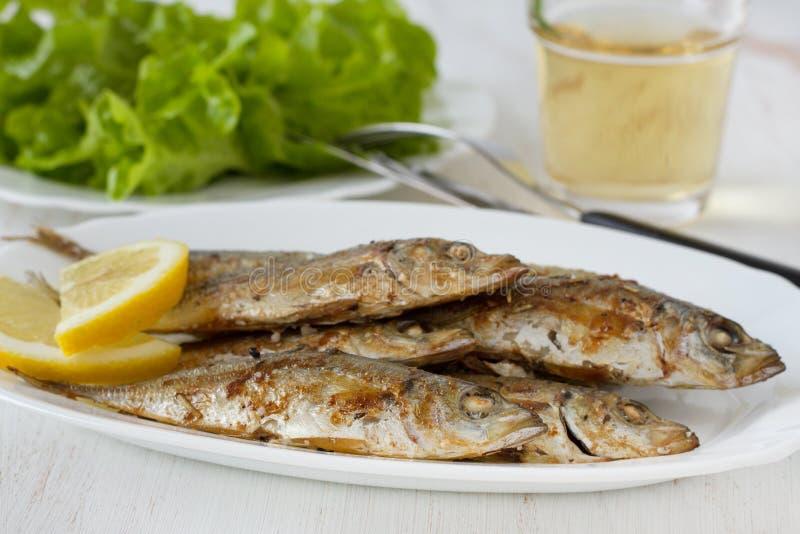 鱼油煎的柠檬 免版税库存图片