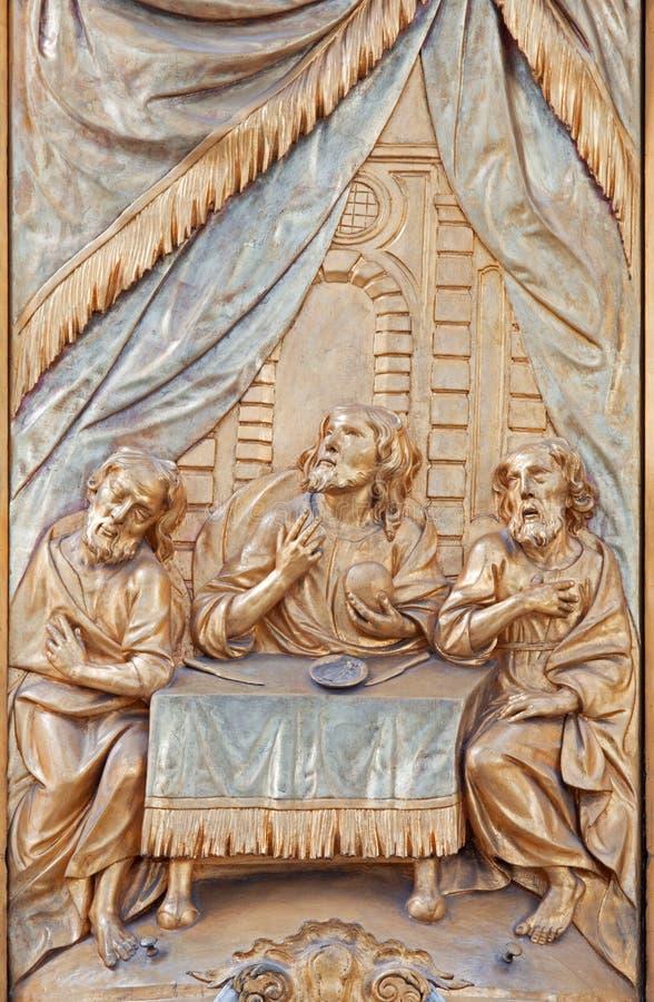 鲁汶-场面耶稣被雕刻的安心与传道者的在Emauzy在Sint Doperkerk 1月de 免版税库存图片