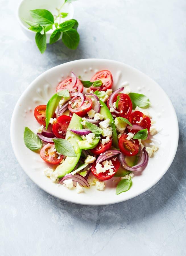 鲕梨和西红柿沙拉 库存照片